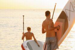 two men going paddleboarding