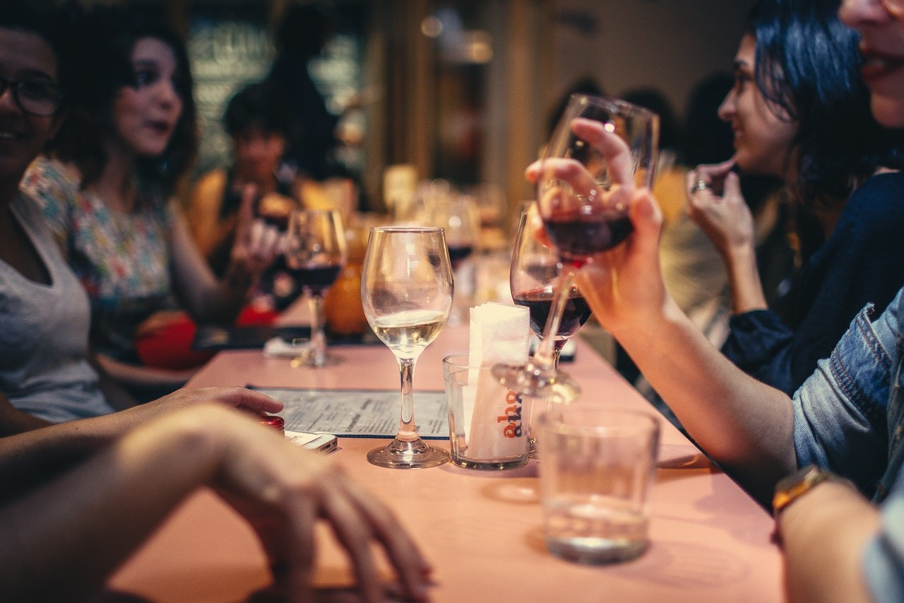 people at dinner drinking wine
