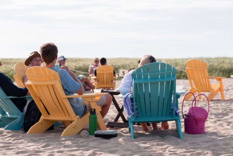 people on the beach in chairs