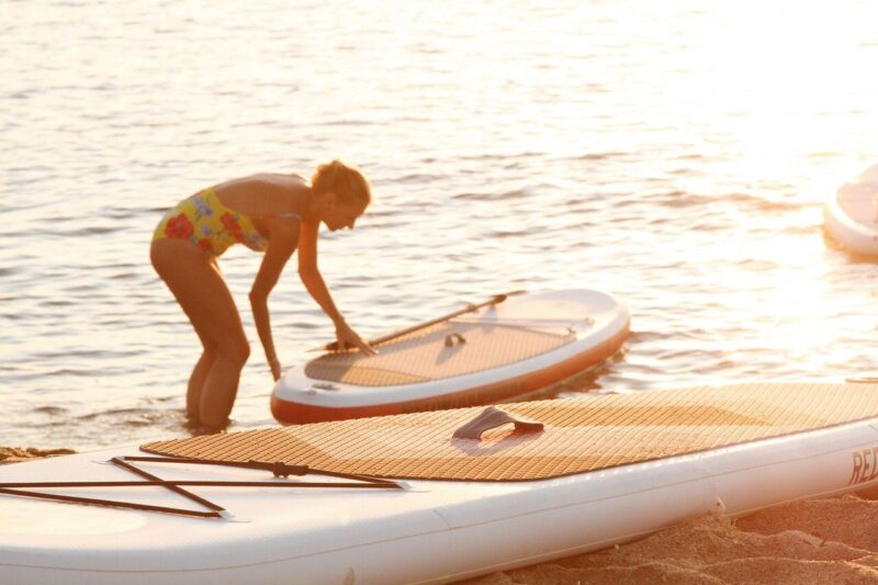 paddle boards and a woman