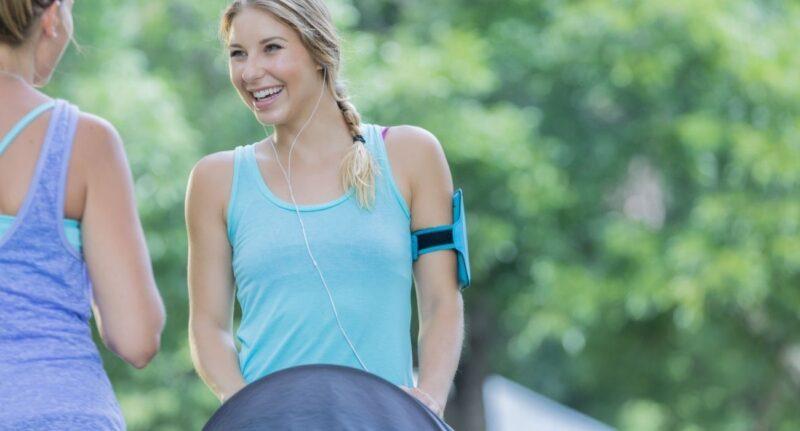 woman exercising pushing jogging stroller