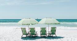 green beach chairs and umbrellas